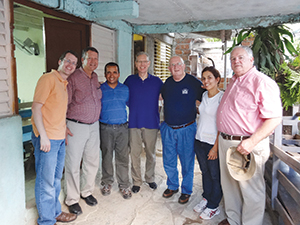 A team of Baptists from Missouri and a Cuban pastor and translator pose for a photo outside a church building on the outskirts of Santiago de Cuba. They are (l-r) Brian Kaylor and Gary Snowden, of Churchnet; Cuban pastor Joey; John Jackson, Future Leadership Foundation; Roger Hatfield, FLF and The Baptist Home; Cuban translator Ester; and Steven Jones, TBH. Another Missouri team member was Steve Hemphill, FLF, who was not present for the photo.