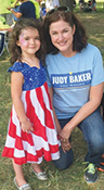 Judy Baker, candidate for Missouri treasurer, visits with a young girl during a Labor Day event.