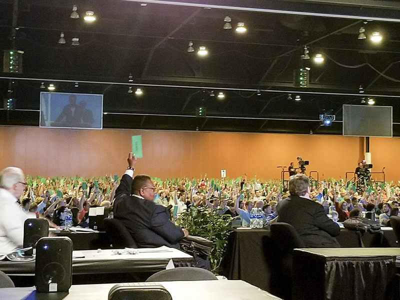 "Messengers raise their ballots to approve a request by the Resolutions Committee to present a resolution on ""anti-Gospel alt-right white supremacy"" at the Southern Baptist Convention annual meeting at the Phoenix Convention Center. Photo courtesy of Philip Bethancourt"