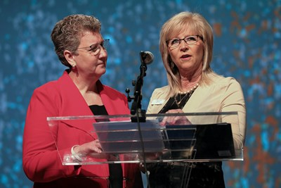 Woman's Missionary Union Executive Director and Treasurer Sandra Wisdom-Martin, left, and national WMU President Linda Cooper deliver the WMU report June 14 on the last day of the two-day Southern Baptist Convention annual meeting at the Phoenix Convention Center. The report highlighted the Christian Women's and Men's Job Corps. Photo by Matt Jones