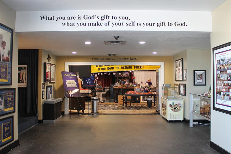 "Signs at Gallery Furniture in Houston display inspirational messages reflective of owner Jim ""Mattress Mack"" McIngvale's faith in God and tout the value of hard work and buying American products to support American jobs. RNS photo by Bobby Ross Jr."