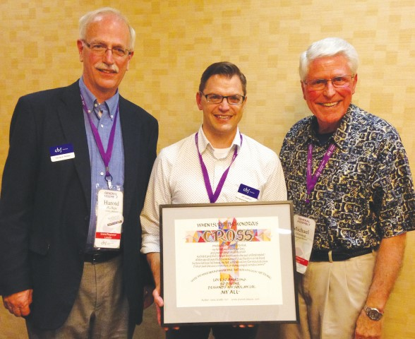 Cooperative Baptist Fellowship Heartland Associate Coordinator Jeff Langford (center) holds the award presented by Moderator Michael Olmsted (right). At left is Harold Phillips, CBF Heartland coordinator. (Photo by Bill Webb)