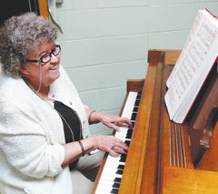 Sharon Lynch plays the piano during worship. A member since 1969, she also leads the lone adult Sunday School class. (Brian Kaylor)