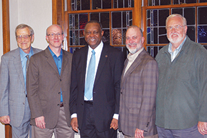 Neville Callam (center), executive secretary of the Baptist World Alliance, poses with guests after an afternoon tea at University Heights Baptist