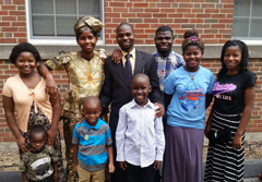 Freddy Lumande (center) and his family were resettled in St. Louis, Mo., from Burundi, where he worked as a Baptist pastor and church planter. His church, located in the capital, was working to strengthen churches in more rural communities. He and his oldest son have found good jobs, and the other children are happy attending school. Still, he struggles with the knowledge that his family, friends and church members still in Bujumbura, where violence has plagued the capital for several months. He balances a modest budget to support his growing family here while sending money home to Burundi to support the rest of his family and the efforts of the church there. (Tower Grove Baptist Church, St. Louis)