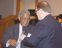 Lim Hill (right) acknowledges new Churchnet President Forestal Lawton, director of church operations, Metropolitan Missionary Baptist Church, Kansas City, Mo.