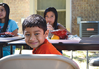 School-age children enjoy a free meal at a summer meals site in Alamo, Texas.