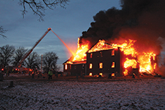 Firefighters engage a fire that engulfed rural Antioch Baptist Church building in Ralls County, Missouri, after midday on Dec. 20., but the flames destroyed the structure despite their best efforts. (Photos by Eric Dundon, courtesy of the Hannibal Courier-Post)