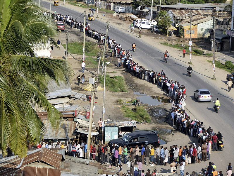 Voters queue to cast their votes at Ziwa la Ng'ombe polling station, in the coastal town of Mombasa, Kenya, on Aug. 8, 2017. Kenyans are going to the polls to vote in a general election after a tightly fought presidential race between incumbent President Uhuru Kenyatta and main opposition leader Raila Odinga. (AP Photo)