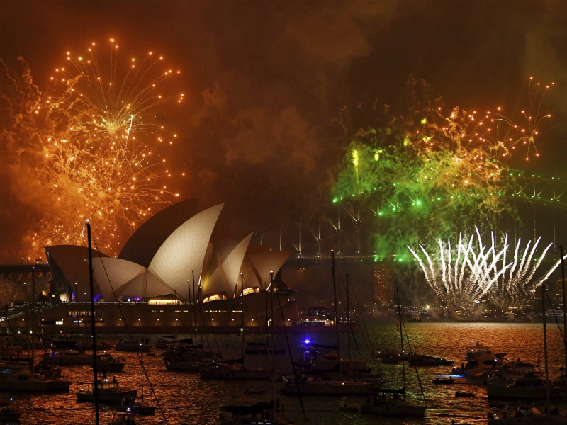 Fireworks explode over Sydney Harbor during New Year's Eve celebrations in Sydney, Australia, Sunday, Dec. 31, 2017. (David Moir/AAP Image via AP)