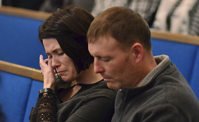 A woman wipes tears from her eye during a prayer vigil at Briensburg Baptist Church near Benton, Ky., on Tuesday, Jan. 23, 2018. Bailey Nicole Holt and Preston Ryan Cope, both 15, were killed and another 17 people injured when a classmate opened fire Tuesday morning in the Marshall County High School atrium, a common area at the school where several hallways meet and students gather before classes. (AP Photo/Stephen Lance Dennee)