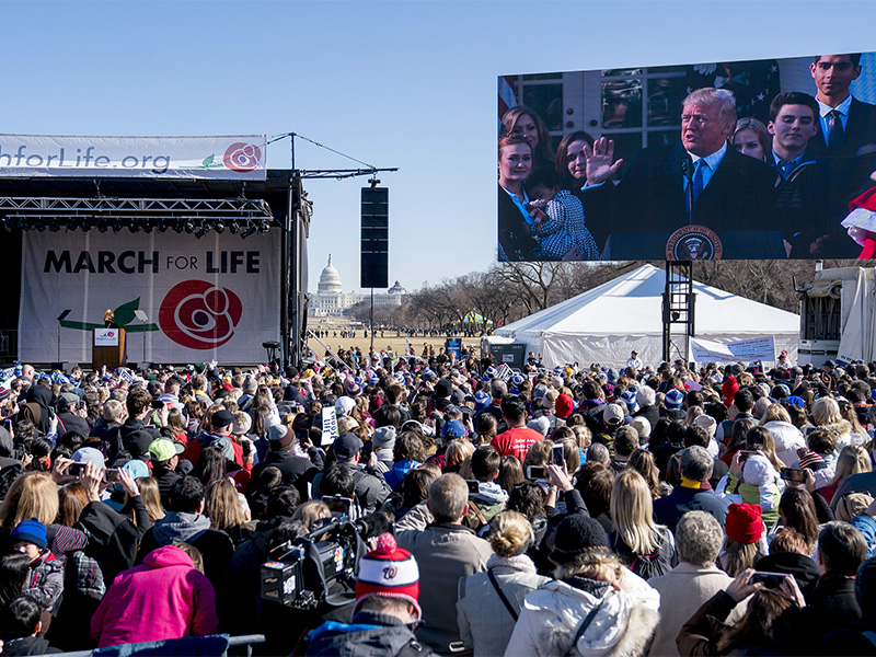 President Trump speaks via a live feed to anti-abortion activists as they rally on the National Mall in Washington on Jan. 19, 2018, during the annual March for Life. (AP Photo/Andrew Harnik; caption amended by RNS)