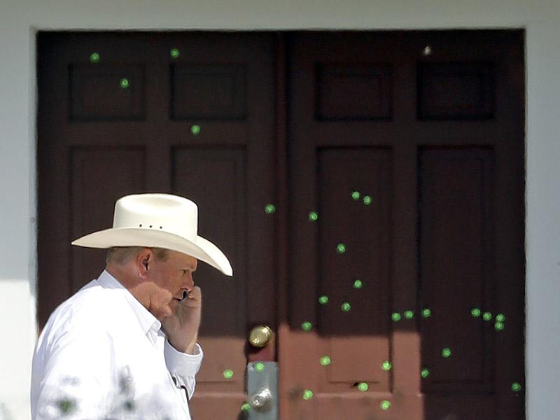 Wilson County Sheriff Joe Tackitt Jr. walks past the front doors where bullet holes were marked by police at the First Baptist Church, on Nov. 7, 2017, in Sutherland Springs, Texas. (AP Photo/David J. Phillip; caption amended by RNS)