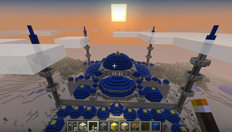 An aerial sunset view of a Blue Mosque creation in Minecraft from the player point of view. Screenshot from YouTube