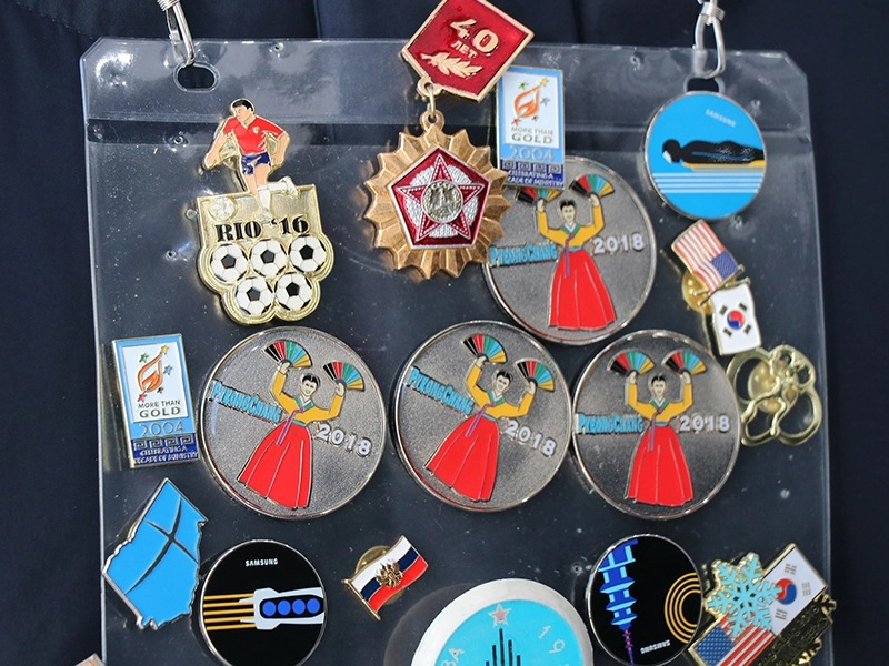 Trading lapel pins is one strategy missionaries use to start discussions with Olympic athletes and visitors in South Korea for the games. (RNS photo: Madeline C. Mulkey)