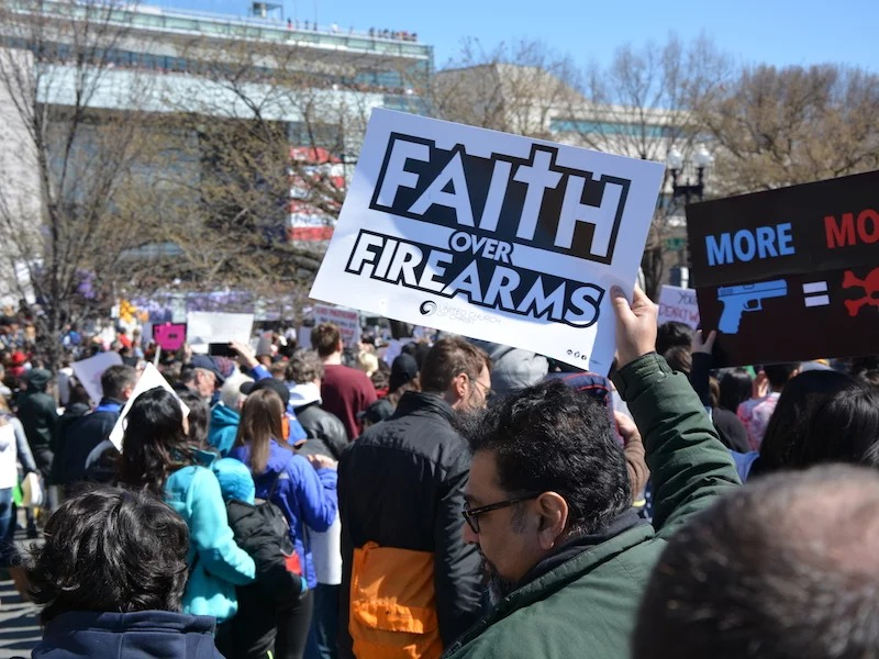 A faith-based protester holds aloft a sign at the March for Our Lives demonstration in Washington, D.C. on March 24, 2018. RNS photo by Jack Jenkins.