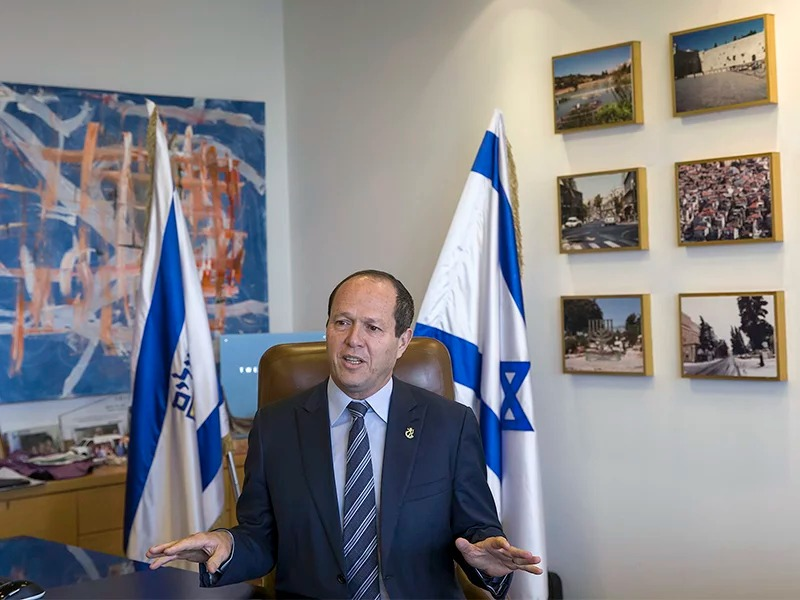 Jerusalem Mayor Nir Barkat speaks in Jerusalem on Feb. 27, 2018. Barkat said that he was working with a third party to resolve a tax dispute with major Christian denominations that led to the closure of the Church of the Holy Sepulchre, one of Christianity's holiest sites, just ahead of the busy Easter season. The mayor later suspended plans to collect taxes from churches. (AP Photo/Tsafrir Abayov)
