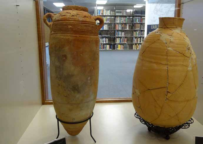 Two pottery jars with books in the SBU library in the background. The one on the left is from 100-400 A.D. The one of the right is from the 1st century A.D. (Photo: Brian Kaylor)