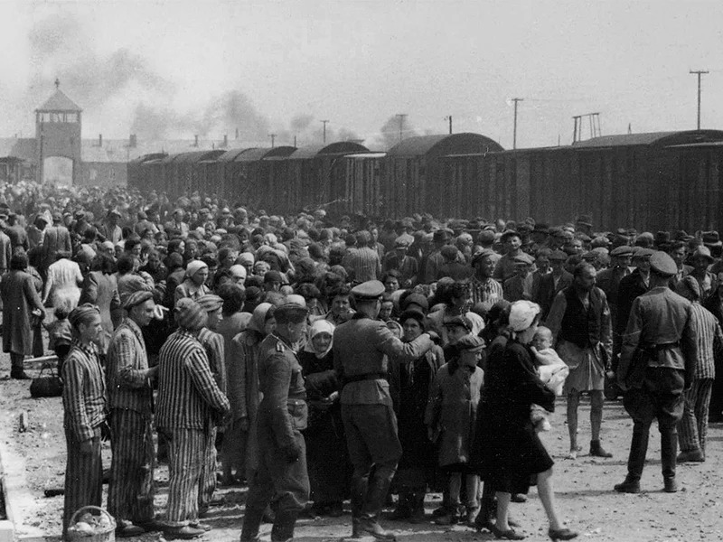 """The """"selection"""" of Hungarian Jews on the ramp at the death camp Auschwitz-II (Birkenau) in Poland during German Nazi occupation in May/June 1944. Jewish arrivals were sent either to work or to the gas chamber. Photo courtesy of Creative Commons"""