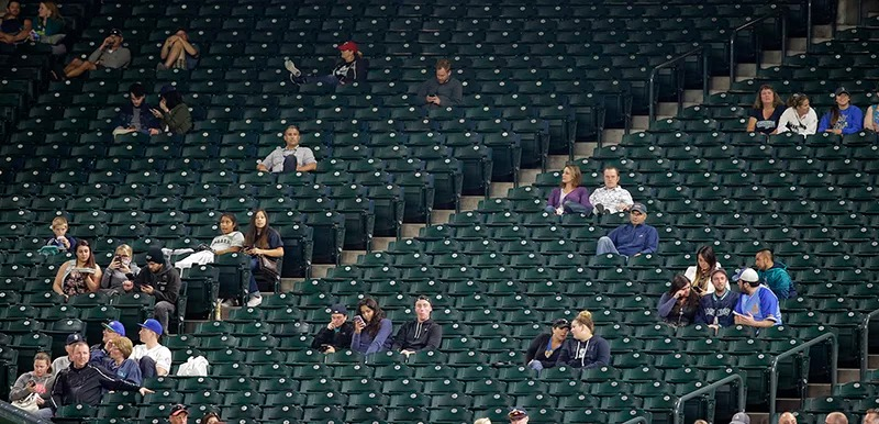 Large sections of empty seats are shown during the sixth inning of a baseball game between the Seattle Mariners and the Texas Rangers at Safeco Field, on Sept. 8, 2015, in Seattle. The announced attendance of 13,389 was the smallest home crowd of the 2015 season for the Mariners. Many MLB teams struggle with low attendance. (AP Photo/Ted S. Warren)