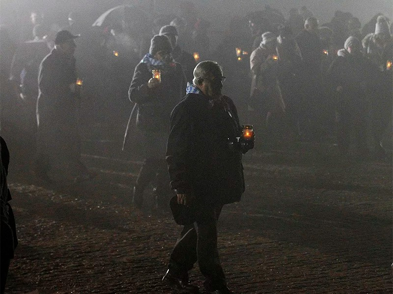 Survivors of Auschwitz arrive at the International Monument to the Victims of Fascism at the former Nazi German concentration and extermination camp KL Auschwitz II-Birkenau on International Holocaust Remembrance Day in Oswiecim, Poland, on Jan. 27, 2018. (AP Photo/Czarek Sokolowski)