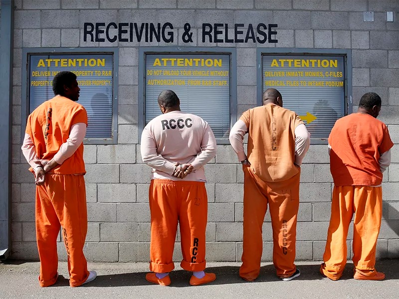 Prisoners from Sacramento County await processing after arriving at the Deuel Vocational Institution in Tracy, Calif., on Feb. 20, 2014. (AP Photo/Rich Pedroncelli)