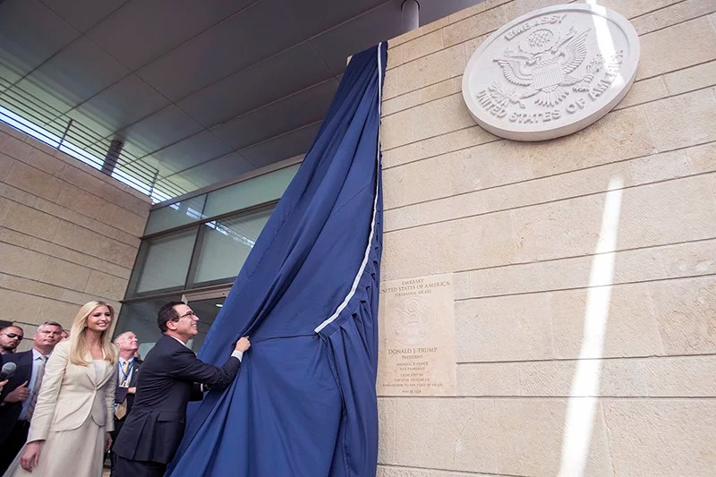 U.S. President Trump's daughter Ivanka, left, and U.S. Treasury Secretary Steve Mnuchin unveil a plaque during the opening ceremony of the new U.S. embassy in Jerusalem, on May 14, 2018. Amid deadly clashes along the Israeli-Palestinian border, President Trump's top aides and supporters on Monday celebrated the opening of the new U.S. Embassy in Jerusalem as a campaign promise fulfilled. (Flash90 Photo/Yonatan Sindel via AP)
