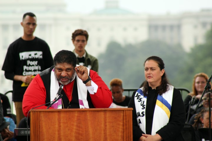 The Rev. William Barber II, left, and the Rev. Liz Theoharis, co-chairs of the Poor People's Campaign: A National Call for Moral Revival, lead the rally on the National Mall in Washington on June 23, 2018. RNS photo by Adelle M. Banks