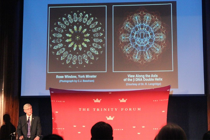 """Francis Collins, bottom left, compares the beauty of a rose window, left, with DNA, right, while speaking at the """"Moving Beyond Conflict: Science and Faith in Harmony"""" event in Washington on June 18, 2018. RNS photo by Adelle M. Banks"""