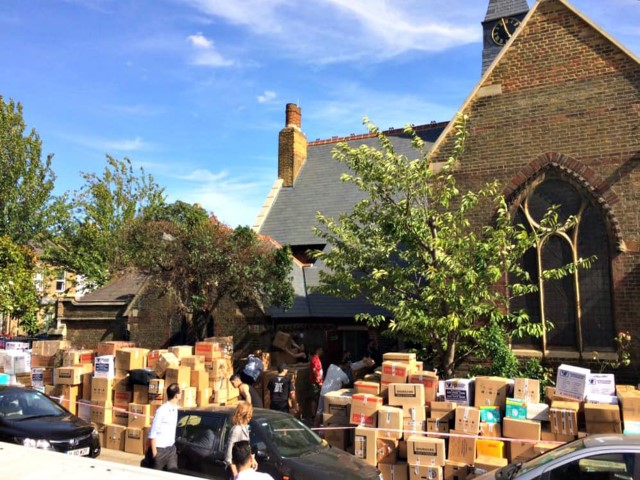Donations are piled outside of St. Clement's Church in Notting Dale after the Grenfell Tower file in west London. Photo courtesy Diocese of London