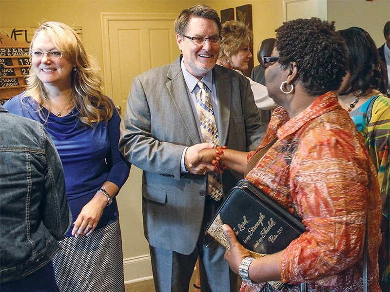 Minister Les Ferguson Jr. and his wife, Becki, left, greet church members after a Sunday morning assembly at the Lake Harbour Church of Christ in Ridgeland, Miss., north of the state capital of Jackson, in 2014. RNS photo by Bobby Ross Jr
