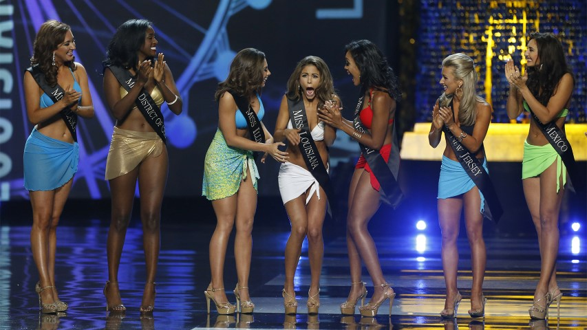 Miss Louisiana Laryssa Bonacquisti, center, reacts after advancing to the evening gown round of the Miss America 2018 pageant on Sept. 10, 2017, in Atlantic City, N.J. (AP Photo/ Noah K. Murray)