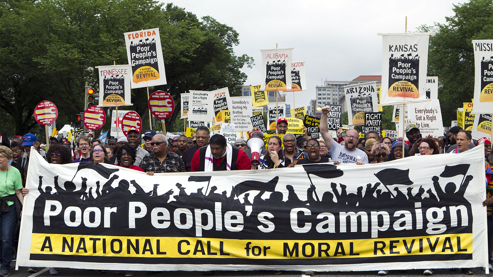 Demonstrators march outside the U.S. Capitol during the Poor People's Campaign rally at the National Mall in Washington on June 23, 2018. (AP Photo/Jose Luis Magana)