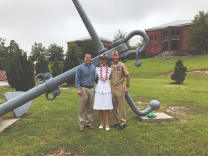 Sarah Greenfield (center) with her husband Blake (left) and father Alan Rogers (right) celebrate Greenfield's graduation from the Naval Chaplaincy School at Fort Jackson in Columbia, S.C., in July 2017.