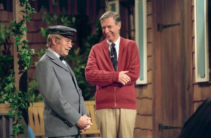 "Fred Rogers, right, and David Newell, as Speedy Delivery's Mr. McFeely, stand on the front porch set while filming an episode of ""Mister Rogers' Neighborhood."" Photo by Lynn Johnson via Focus Features"