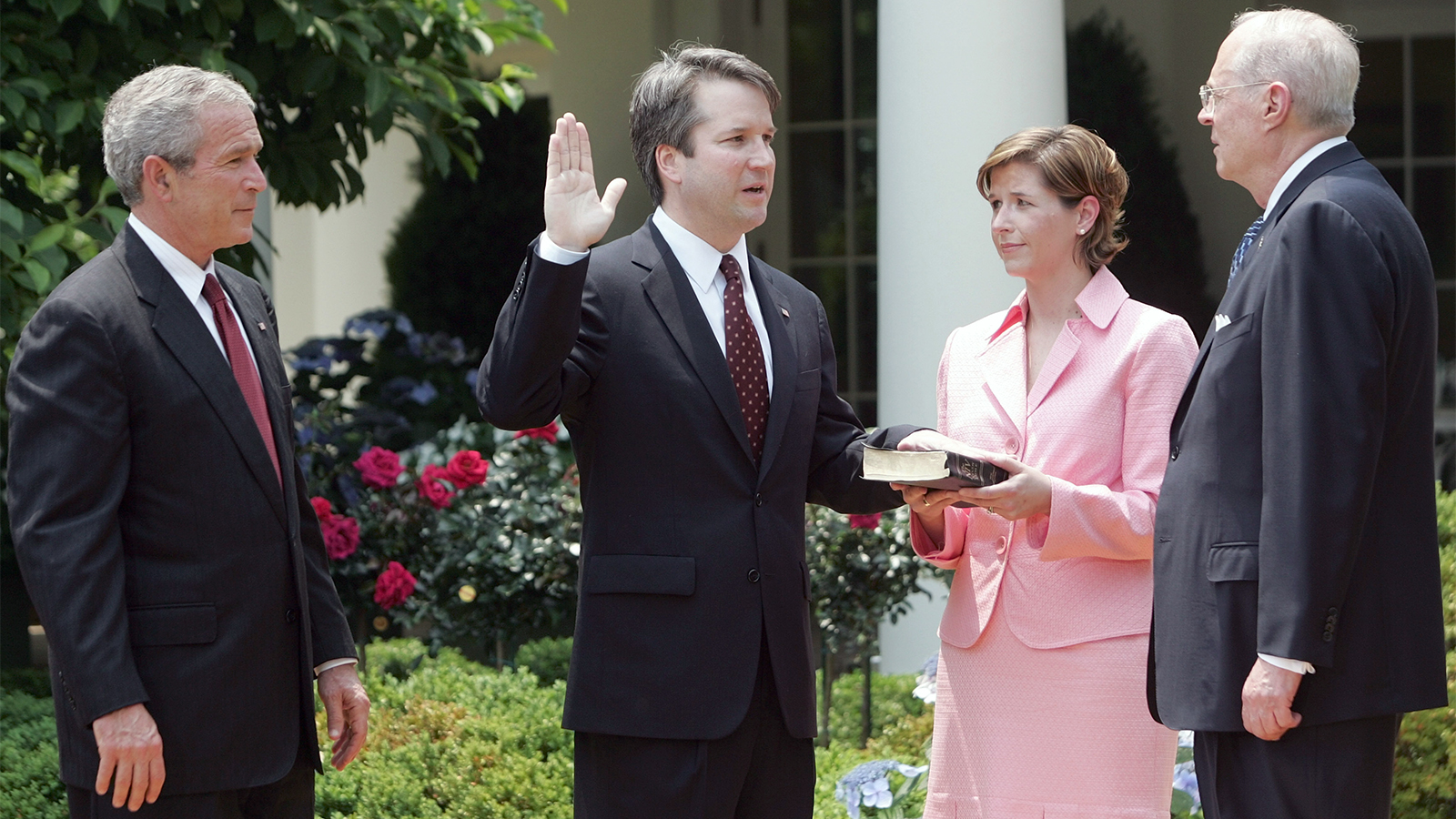 In this June 1, 2006, file photo, from left to right, President Bush watches the swearing-in of Brett Kavanaugh as judge for the U.S. Court of Appeals for the District of Columbia by U.S. Supreme Court Associate Justice Anthony M. Kennedy, far right, during a ceremony in the Rose Garden of the White House, in Washington. Holding the Bible is Kavanaugh's wife, Ashley Kavanaugh. (AP Photo/Pablo Martinez Monsivais)