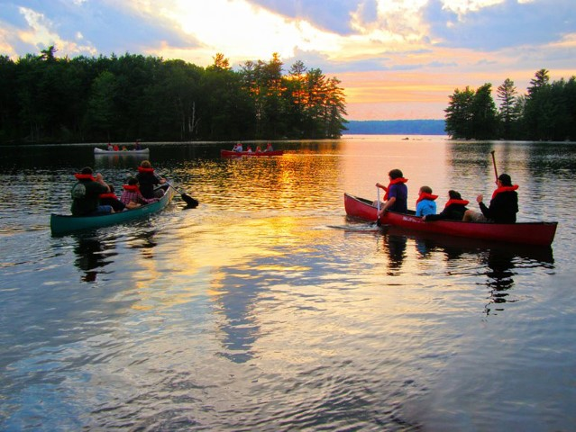 Campers canoe on Cobboseecontee Lake at Pilgrim Lodge in Maine. Photo by Lydia Hoffman/Pilgrim Lodge