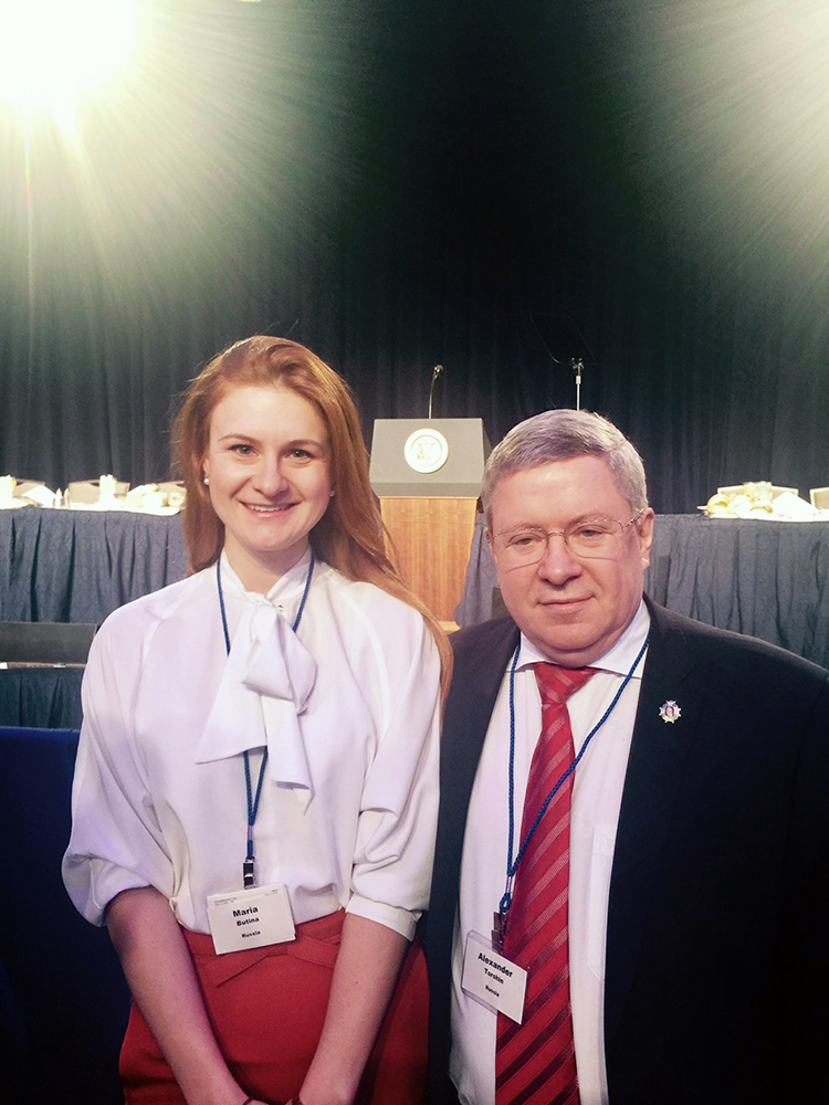 Alleged Russian agent Mariia Butina, left, and Russian politician Alexander Torshin at the 2017 National Prayer Breakfast. President Trump spoke from the podium in the background. Photo via Facebook