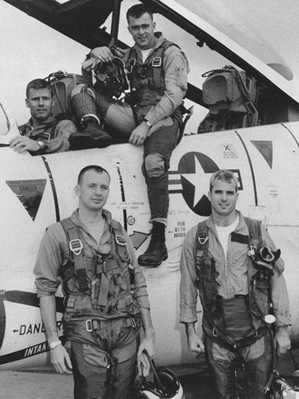 John McCain, front right, with his squadron and T-2 Buckeye trainer in 1965. Photo courtesy of Creative Commons
