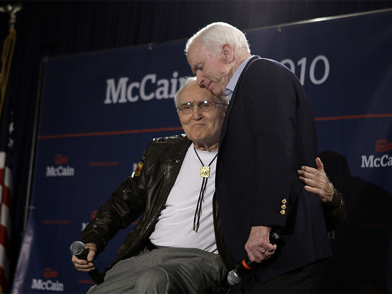 "Sen. John McCain, right, hugs retired Air Force Col. George ""Bud"" Day after Day's endorsement and kind words about the senator at a campaign rally at a Veterans Town Hall Meeting and endorsement news conference at the American Legion Post #1 Luke-Greenway on Feb. 18, 2010, in Phoenix. The two were POW cellmates in Vietnam. (AP Photo/Ross D. Franklin)"