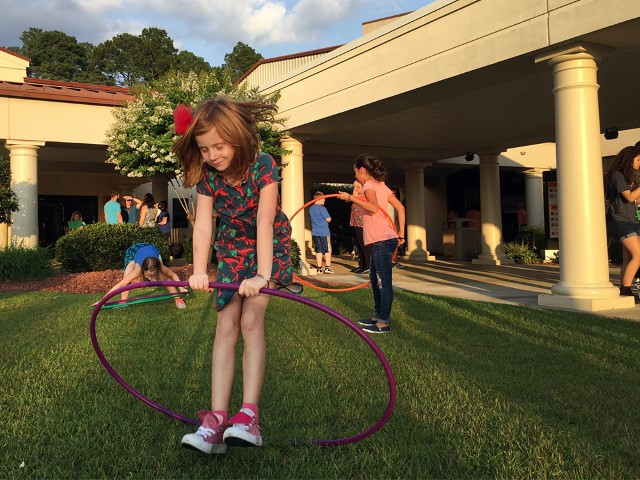 Girls twirl hoola hoops outside Manna Church following a Thursday evening service in Fayetteville, N.C. RNS photo by Yonat Shimron