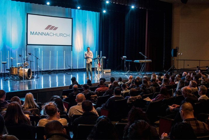 Pastor Joe Adams speaks during a service at Manna Church in Colorado Springs, Colo. held at Pikes Peak Community College. Photo by Will Reinier