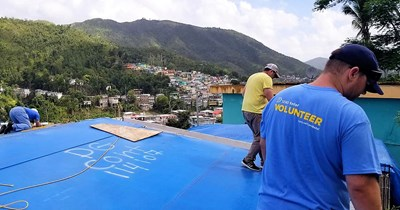 Send Relief volunteers replace a roof on one of tens of thousands of homes still in need of repair in Puerto Rico a year after Hurricane Maria devastated the island. Send Relief photo
