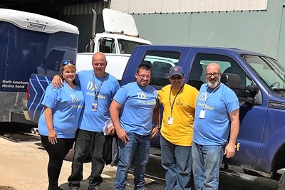 Jonathan Santiago (in yellow shirt), is coordinator of the North American Mission Board Send Relief Ministry Center in Guaynabo, Puerto Rico . Send Relief photo