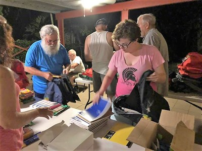 Volunteers from a stateside Southern Baptist church prepare bags of supplies for Puerto Ricans still recovering from Hurricane Maria. Send Relief photo
