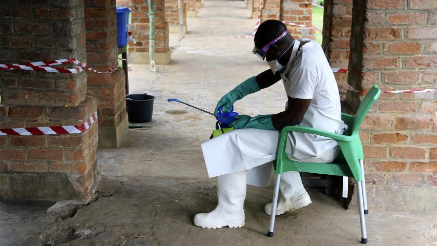 A health care worker wears virus protective gear at a treatment center in Bikoro, Democratic Republic of Congo, on May 13, 2018. (AP Photo/John Bompengo)