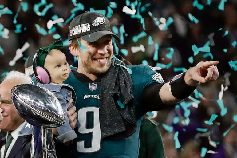 Philadelphia Eagles quarterback Nick Foles holds his daughter, Lily, after beating the New England Patriots in the NFL Super Bowl 52 football game on Feb. 4, 2018, in Minneapolis. Foles, who was named the Super Bowl MVP, is an online graduate student at Liberty University, earning his master's degree in divinity. (AP Photo/Frank Franklin II)