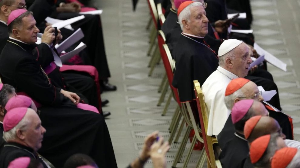 Pope Francis sits among Bishops and Cardinals during a meeting with youths attending the Synod in the Paul VI hall, at the Vatican, Saturday, Oct. 6, 2018. (AP Photo/Gregorio Borgia)
