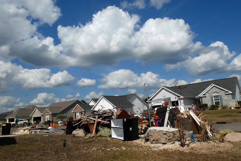 Piles of debris from flood-damaged homes line street after street in Polo Farms in Longs, S.C. Photo by Laura Sikes