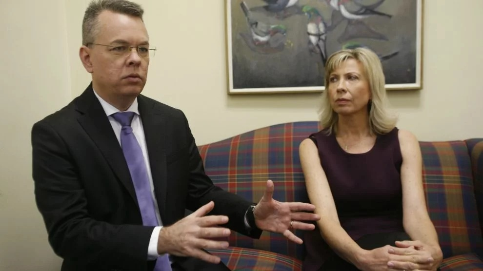 Pastor Andrew Brunson, left, gestures as his wife, Norine, listens during an interview at the headquarters of Christian Broadcasting Network in Virginia Beach, Va., Friday, Oct. 19, 2018. Brunson was recently released from prison in Turkey. (AP Photo/Steve Helber)